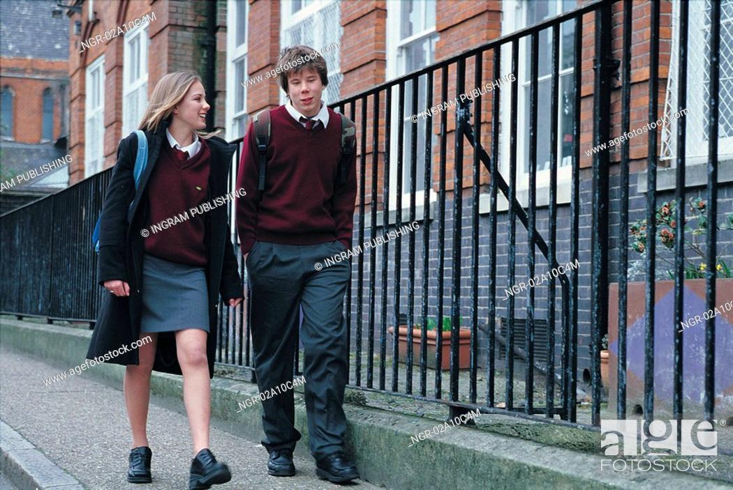 Stock Photo: boy and girl walking to school.