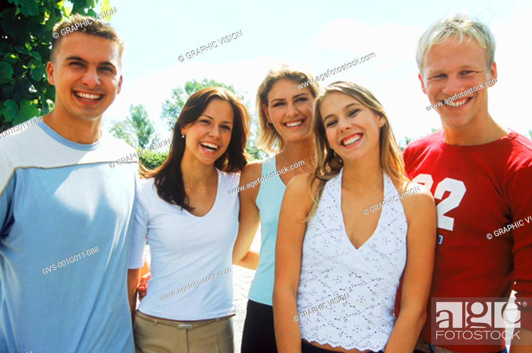 Stock Photo: Portrait of a young group of people smiling.