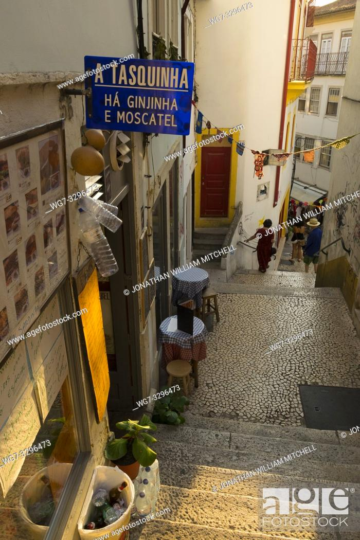 Stock Photo: COIMBRA, PORTUGAL - August 13, 2016: Tourists explore the ancient lanes of the historic university city of Coimbra, Portugal.