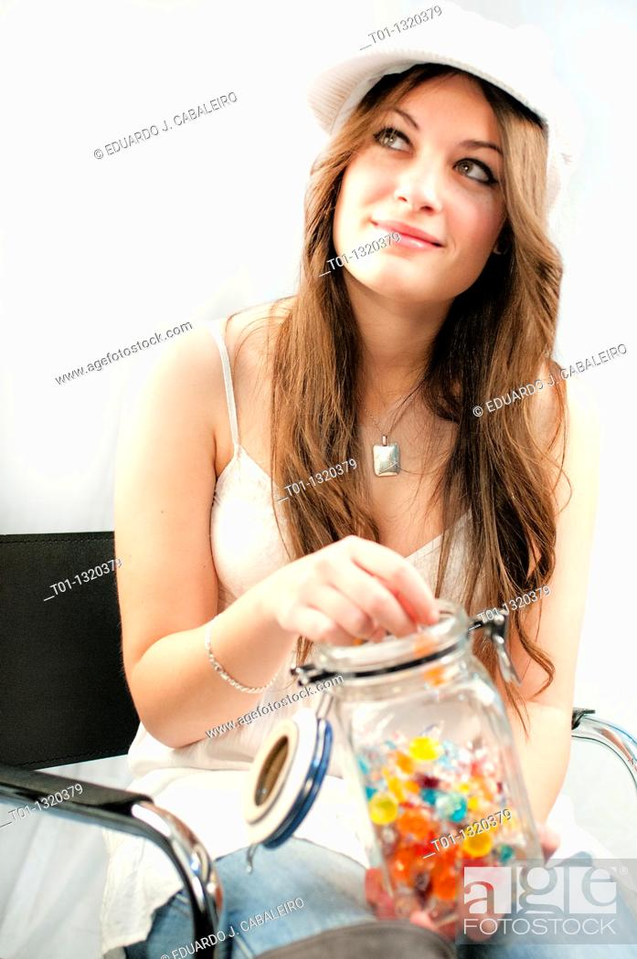 Stock Photo: fashion girl with candy jar.