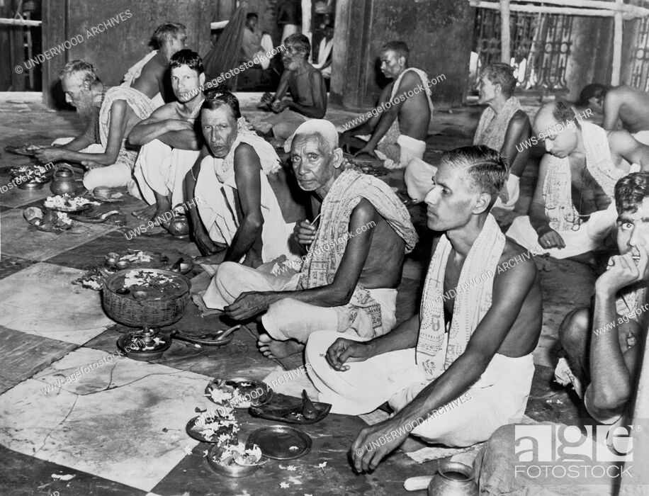 Stock Photo: Kalighat, India: c. 1948.Brahmins worship in the Kalighat temple. Brahmins are the highest caste of HIndus, with their mark of distinciton being the piece of.