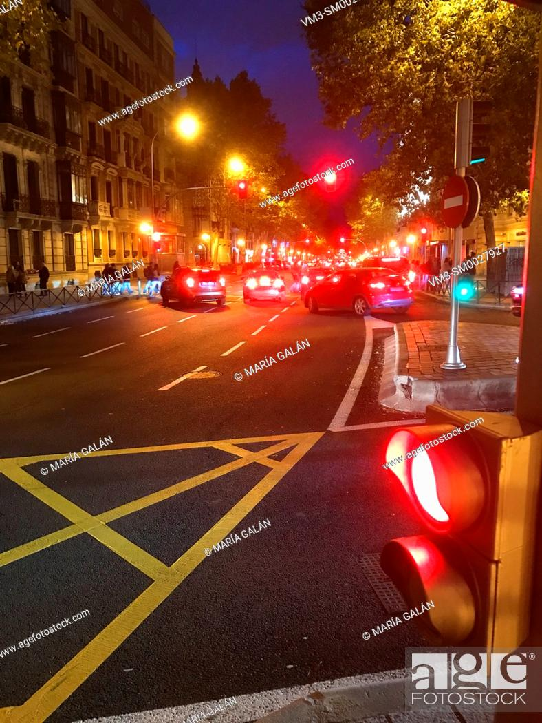 Stock Photo: Street and red traffic light, night view. Velazquez street, Madrid, Spain.