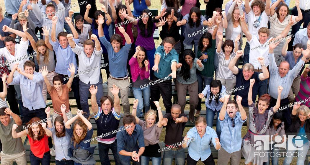Stock Photo: Cheering crowd in bleachers.