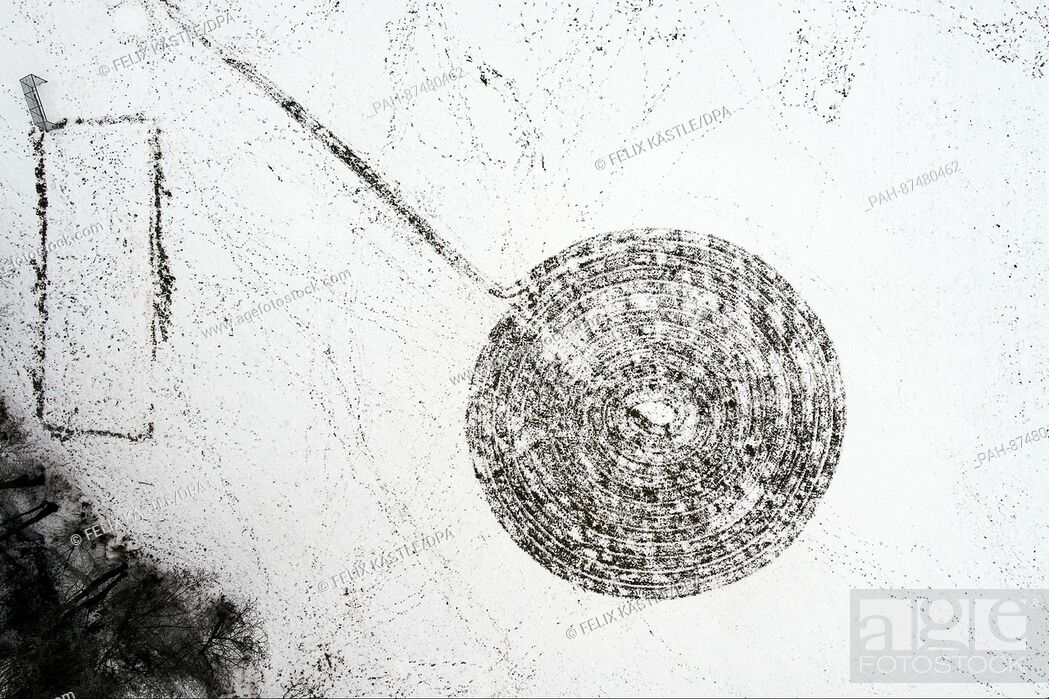 Stock Photo: A football field shows a circular imprint from the bird's-eyes-view in Torweiler, Germany, 24 January 2017. Aerial view taken with a drone.