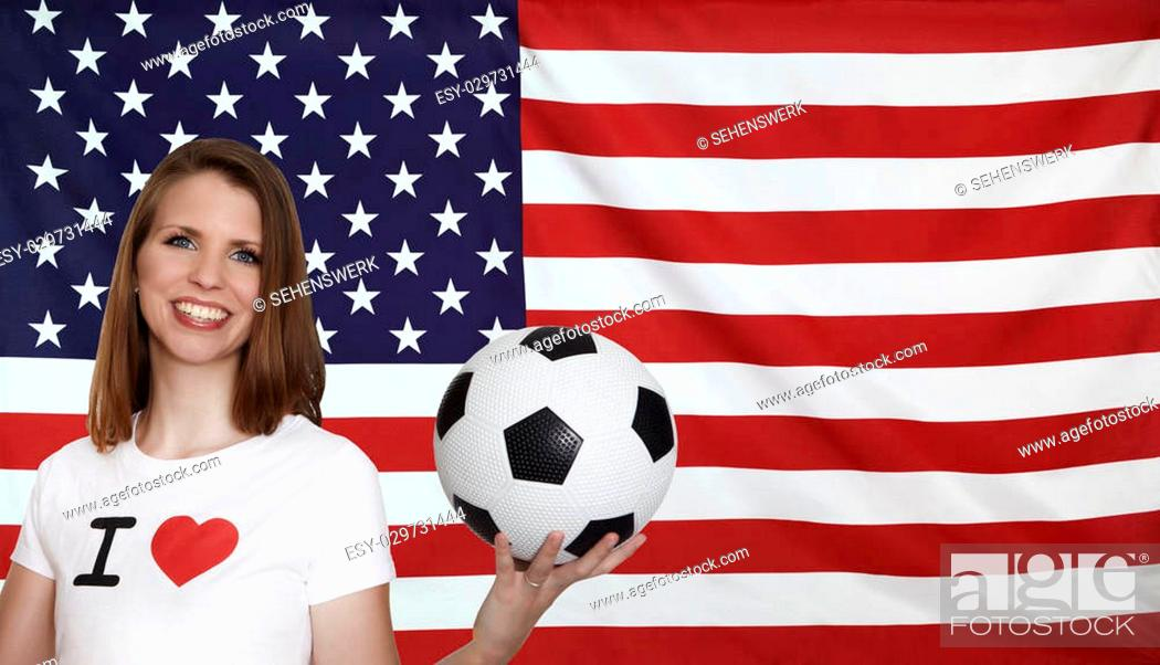 Imagen: USA Flag with female soccer fan with flag in the background.