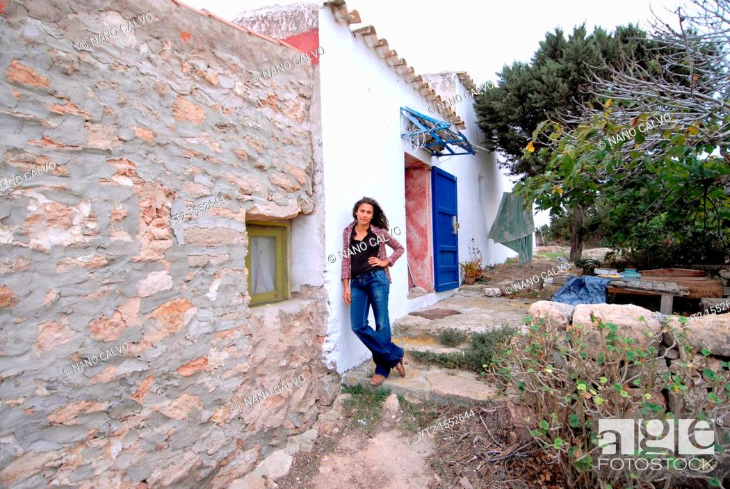 Stock Photo: Brazilian woman posing at her house in Formentera, Spain.