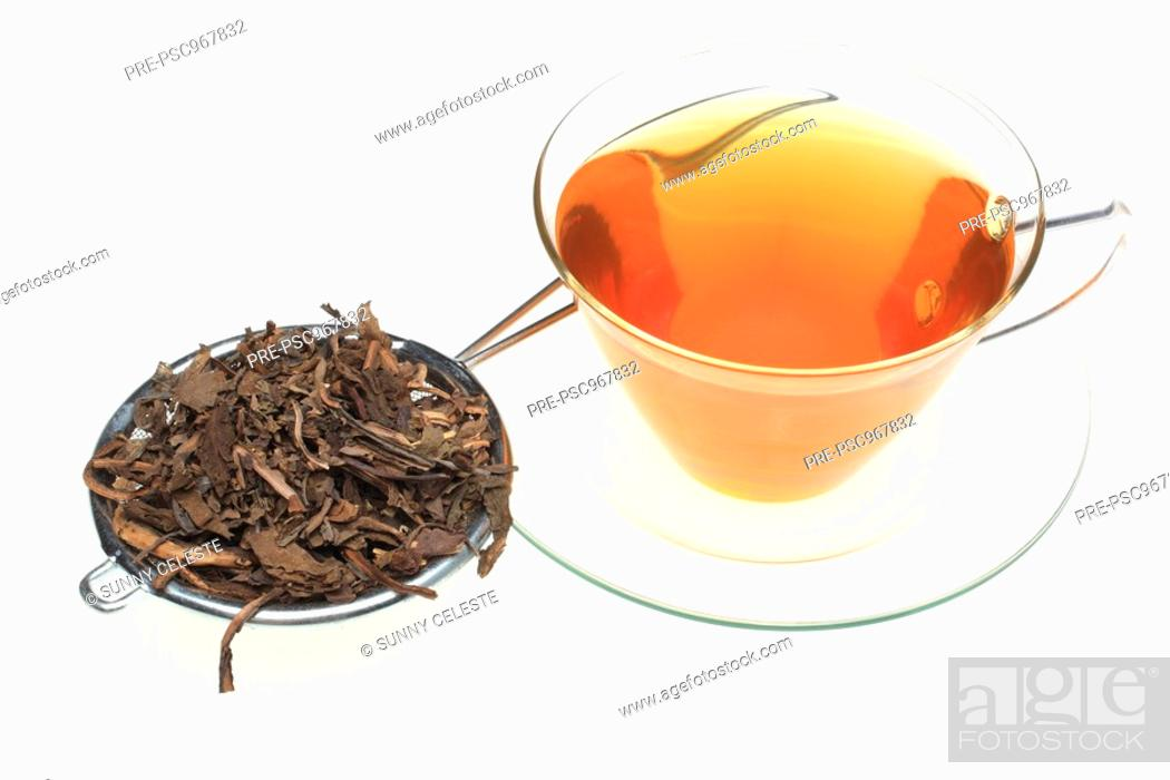 Stock Photo: herbtea made of dried leaves of the medicinal plant common Dyer's weed, Isatis tinctoria.