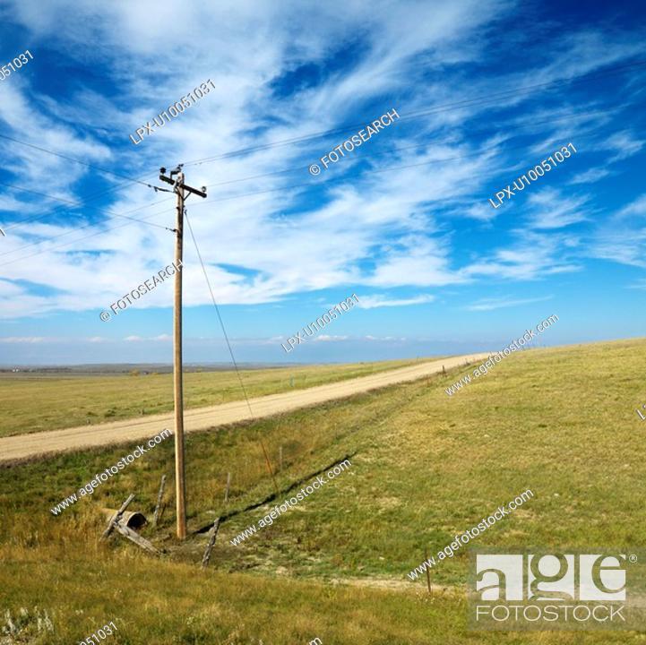 Stock Photo: Power lines alongside dirt road in rural South Dakota.