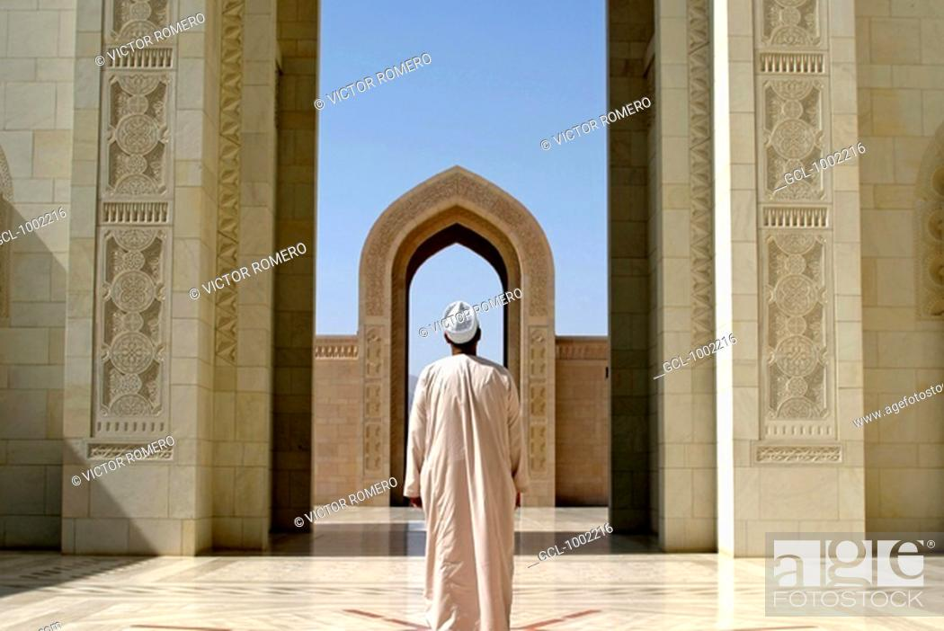 Stock Photo: Muslim praying in the Grand Mosque in Muscat, Oman.