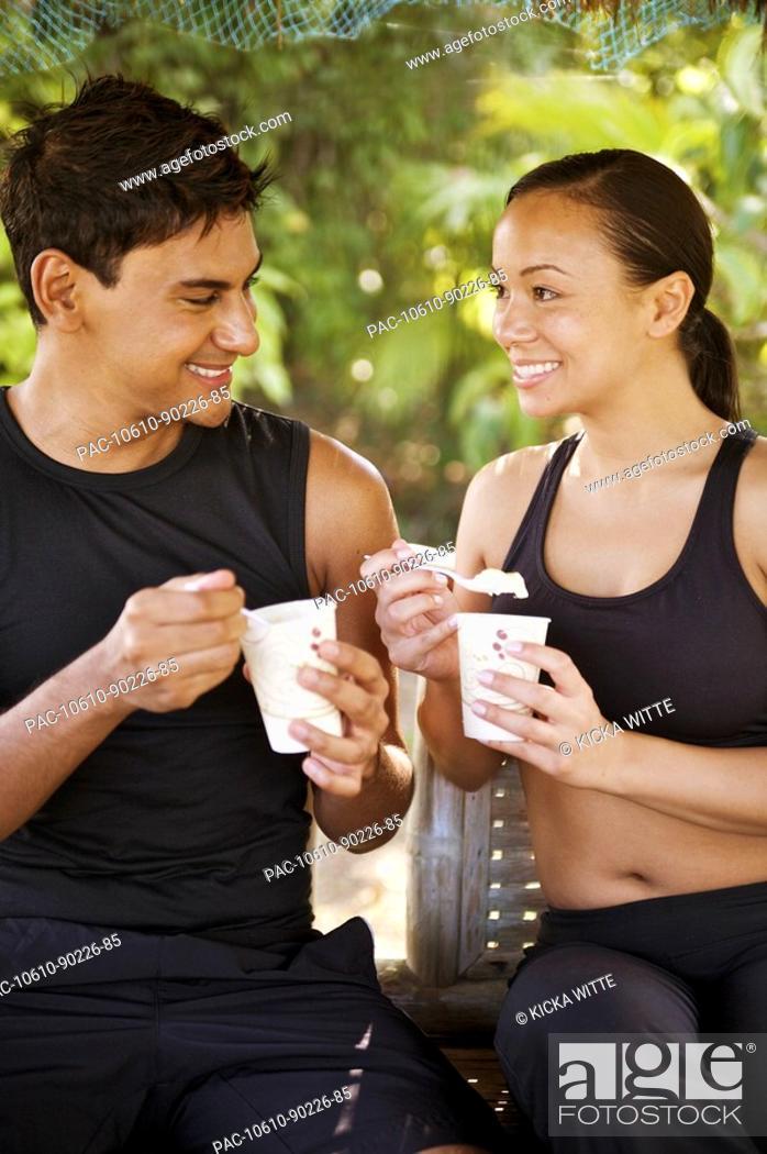 Stock Photo: Hawaii, Kauai, Kilauea, Banana Joe's, Young couple enjoying a frostie treat.