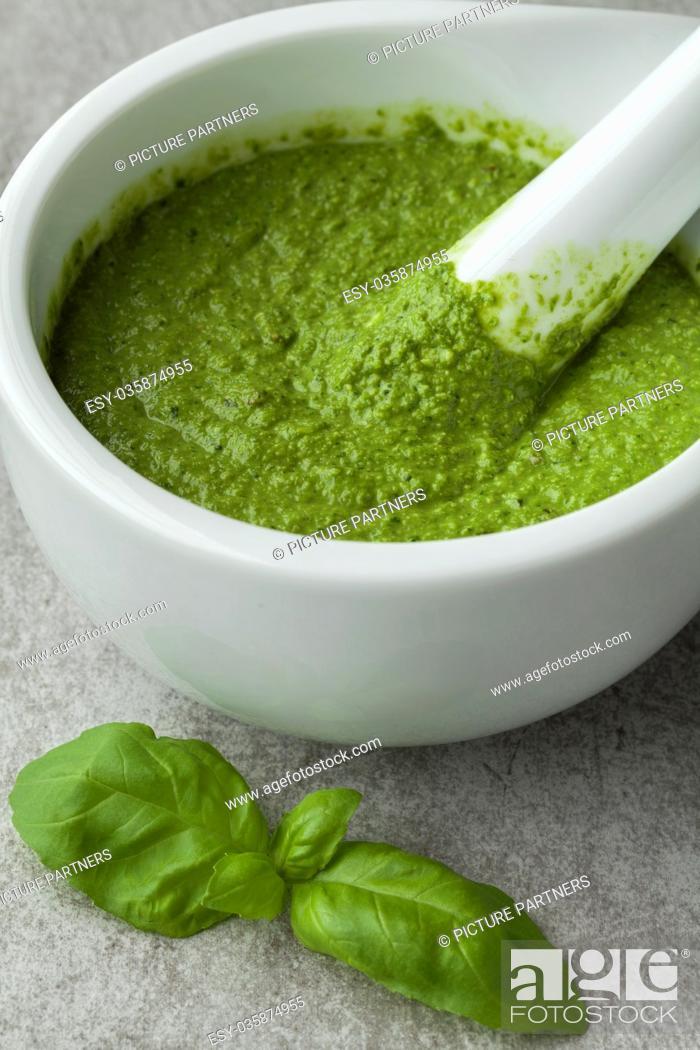 Photo de stock: Green homemade Italian pesto in a mortar.
