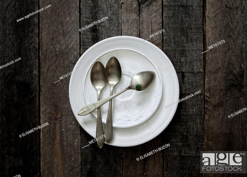 Stock Photo: Plate and spoons in bottom of wood.