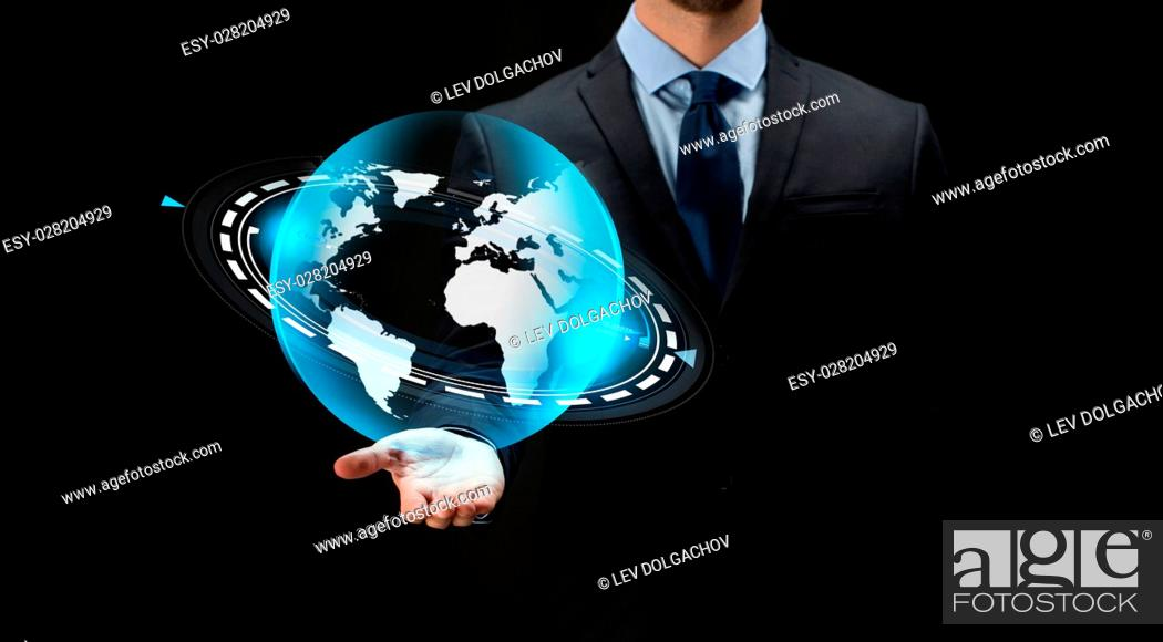 Stock Photo: business, future technology, mass media, cyberspace and people - close up of businessman with virtual earth projection over black background.