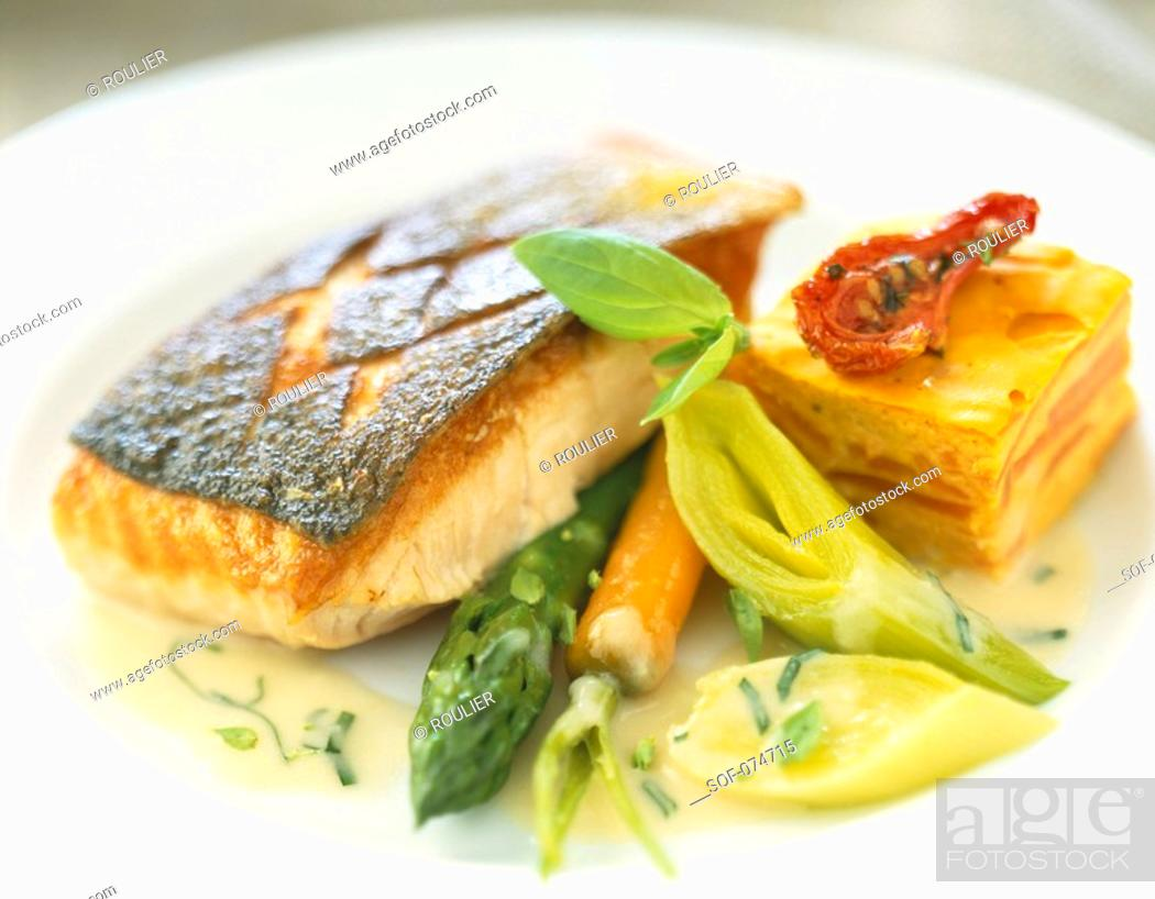Stock Photo: Grilled salmon steak with vegetables and carrot flan.