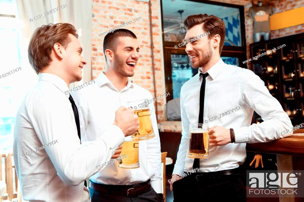 Stock Photo: Coworkers have fun in the bar.