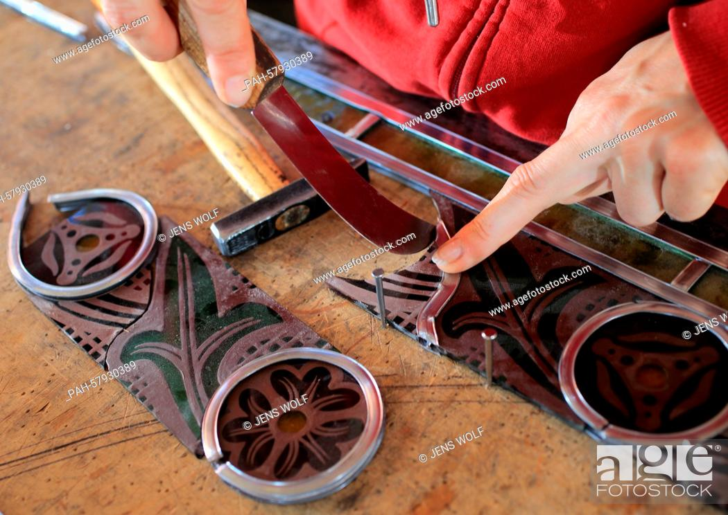 Stock Photo: Staff member Katrin Vater uses traditional methods to restore stained-glass windows for the Wittenberg palace church in the workshop stained-glass window.