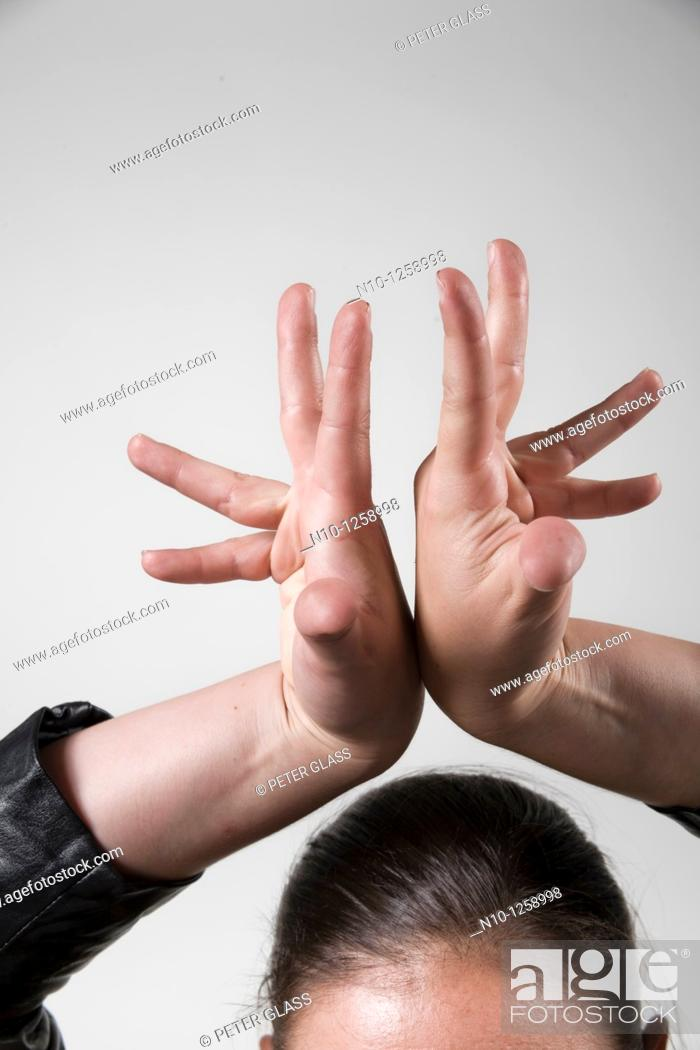 Stock Photo: Young woman's hands.