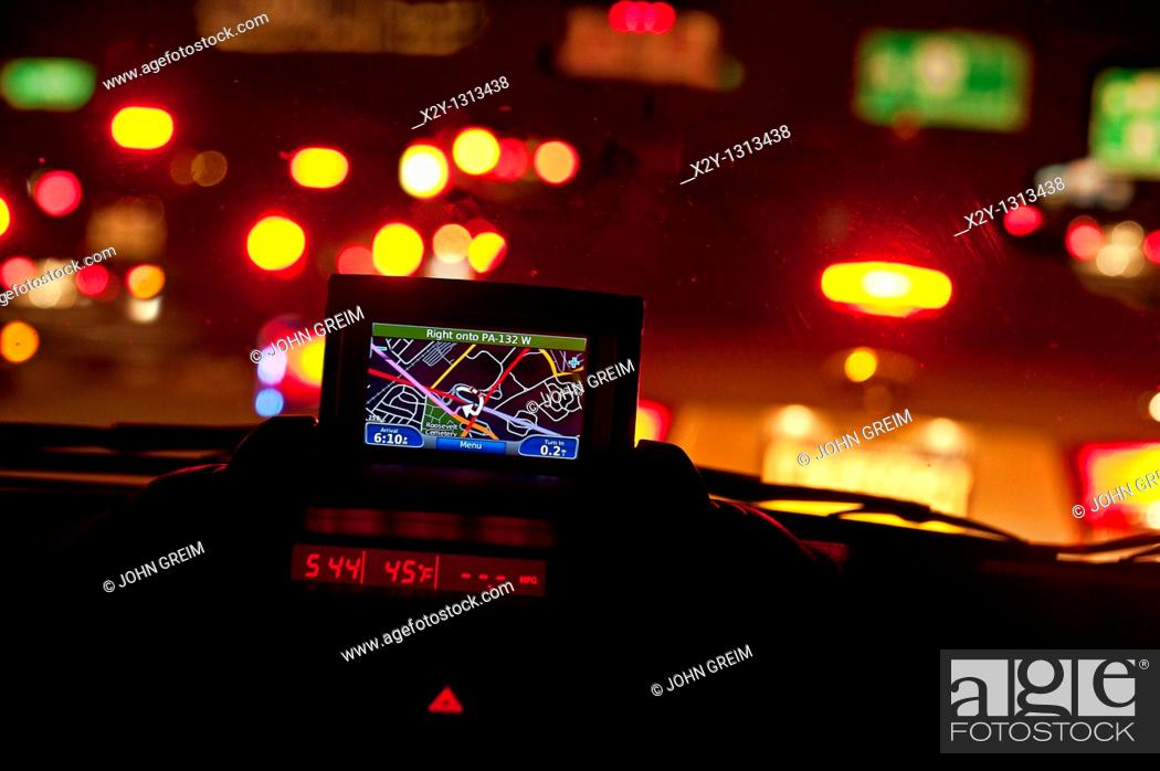 Stock Photo: GPS unit in the window of a car in traffic.