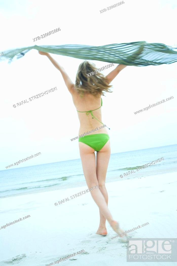 Stock Photo: woman jumping on the beach.
