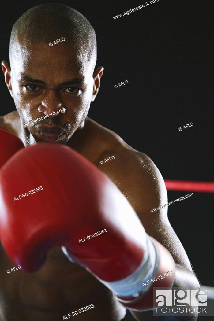 Stock Photo: African boxer in fighting stance.