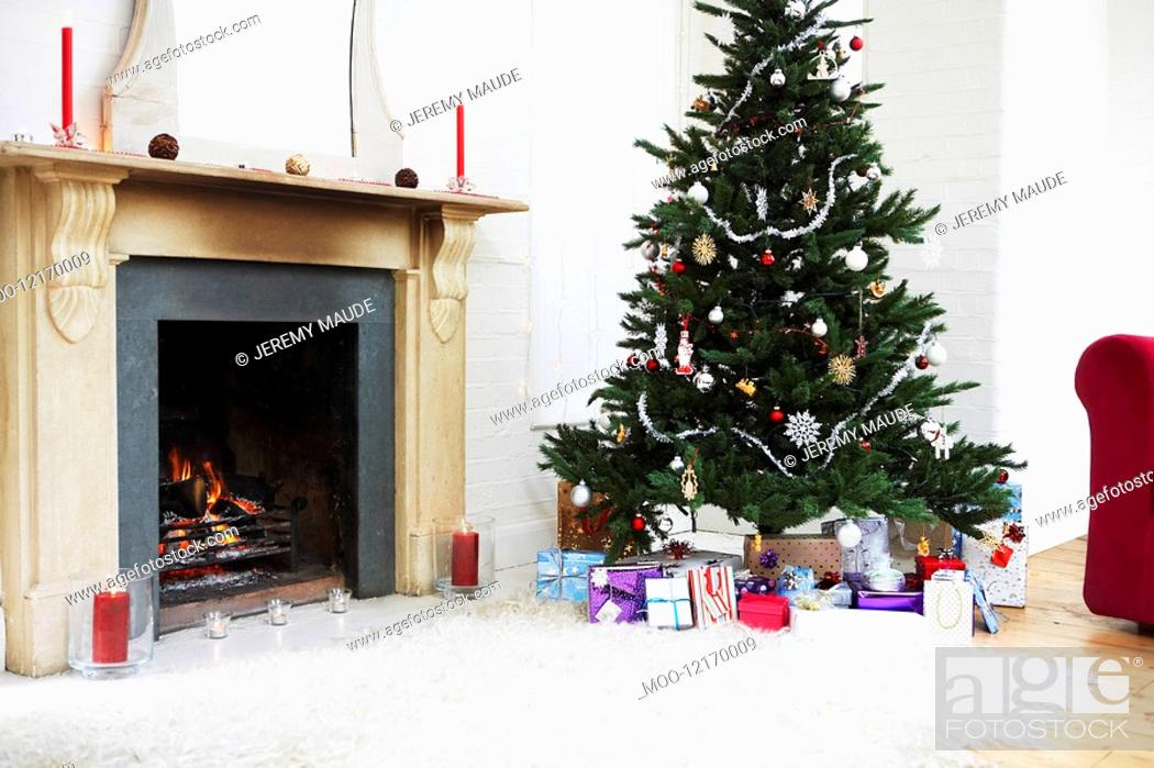 Stock Photo: Fireplace and Christmas Tree with presents.