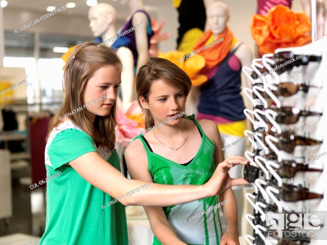 Stock Photo: Two girls shopping sun glasses.