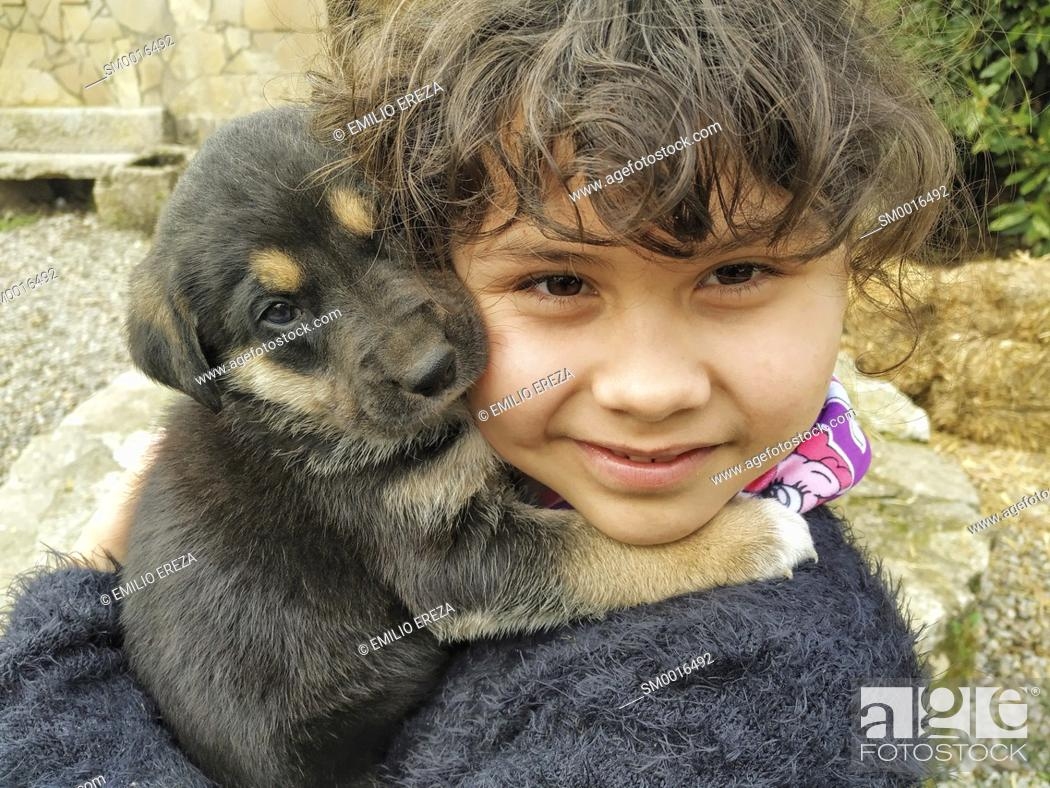 Stock Photo: Little girl with her puppy.