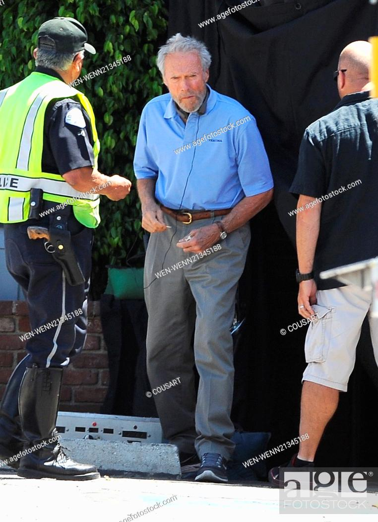 Actor Bradley Cooper puts on a suit for a funeral scene for