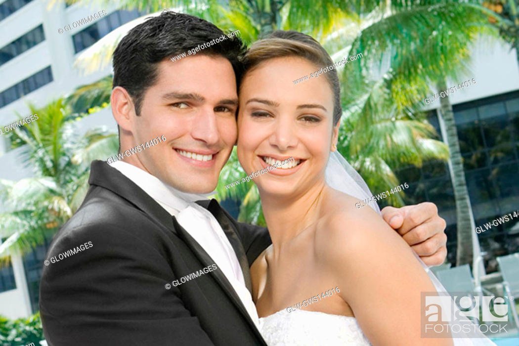 Stock Photo: Portrait of a newlywed couple embracing each other.