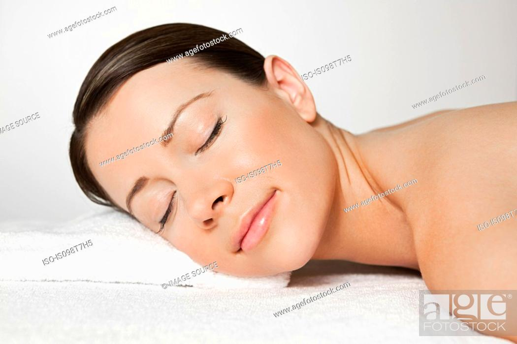Stock Photo: Young woman on massage table.