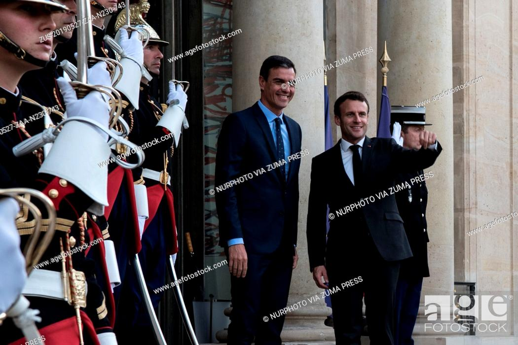 Stock Photo: May 27, 2019 - Paris, France - French President Emmanuel Macron welcomes Spanish Prime Minister Pedro Sanchez prior to a working dinner at the Elysee.