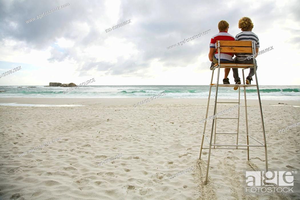 Stock Photo: Two boys on lifeguard tower.