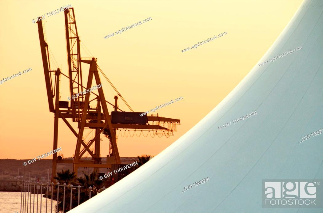 Stock Photo: Cranes and detail of canvass tent, Concept image, the harbour seen at sunset Alicante Spain.