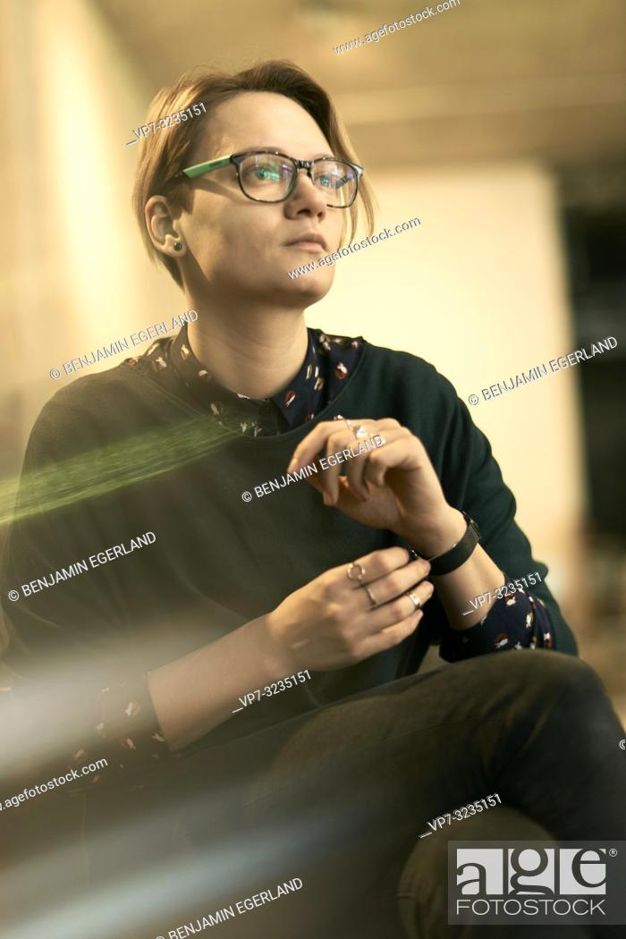 Stock Photo: woman indoors, wearing spectacles, in Munich, Germany.