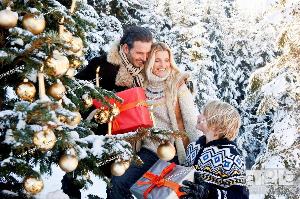 Stock Photo: Austria, Salzburg County, Family celebrating christmas in snow.
