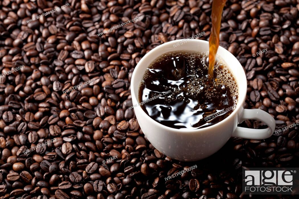 Stock Photo: Coffee Pouring Into Coffee Cup.