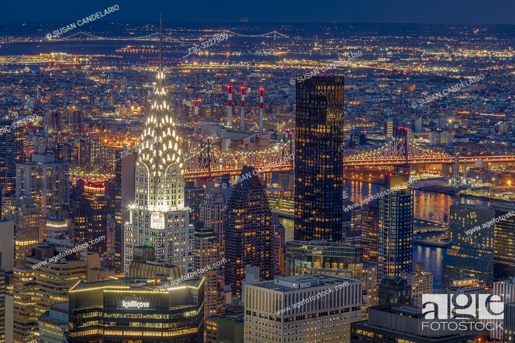 Stock Photo: Chrysler Building NYC Twilight - Upper view to the illuminated midtown Manhattan skyline including the iconic art deco Chrysler building along with the Ed Koch.