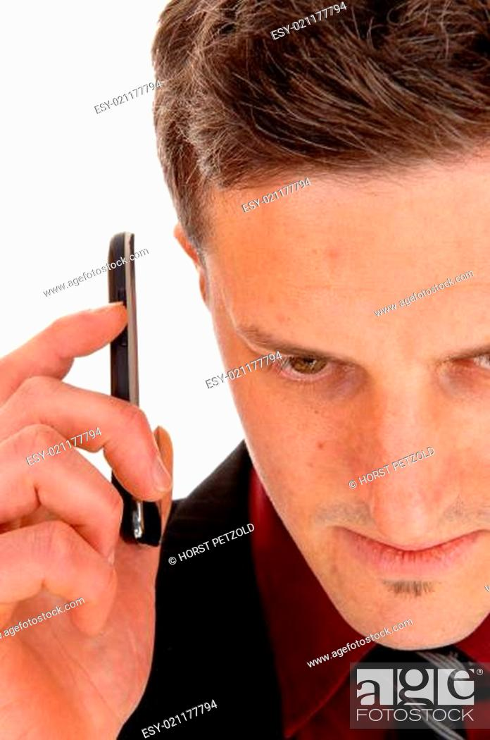 Stock Photo: Man holding cell phone.