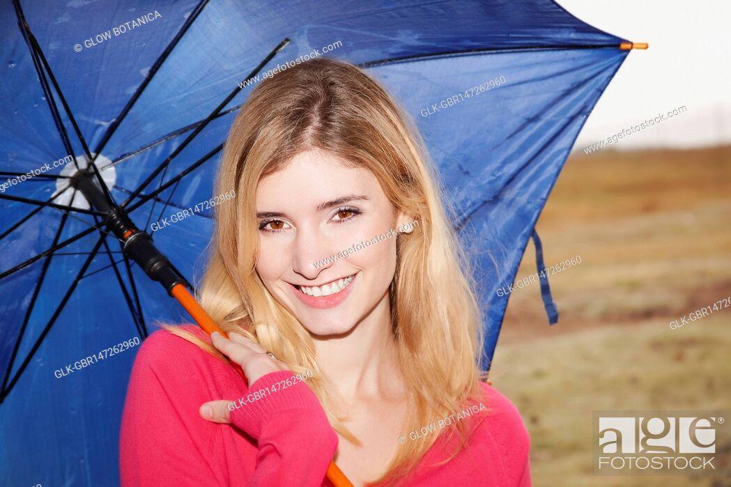 Stock Photo: Woman holding an umbrella.