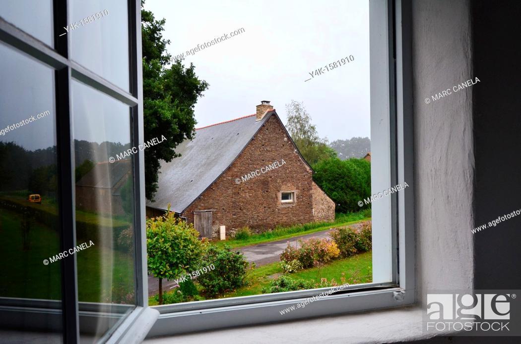 Stock Photo: Europe, France, Bretagne, Brittany region, Boubansais, Pleugueneuc Village, Looking out the window.