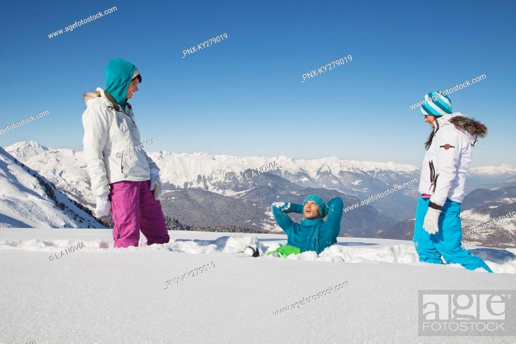 Stock Photo: Couple and daughter playing in snow.