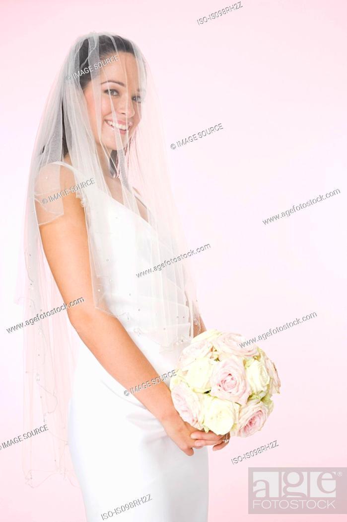 Stock Photo: Portrait of a bride holding a bouquet.
