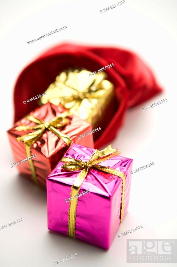 Stock Photo: Gifts out of a red sack.