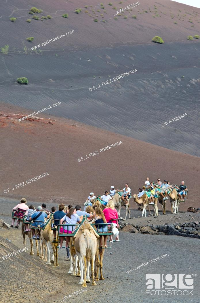 Stock Photo: Tourist group at Timanfaya  Lanzarote, Canary Islands, Spain.