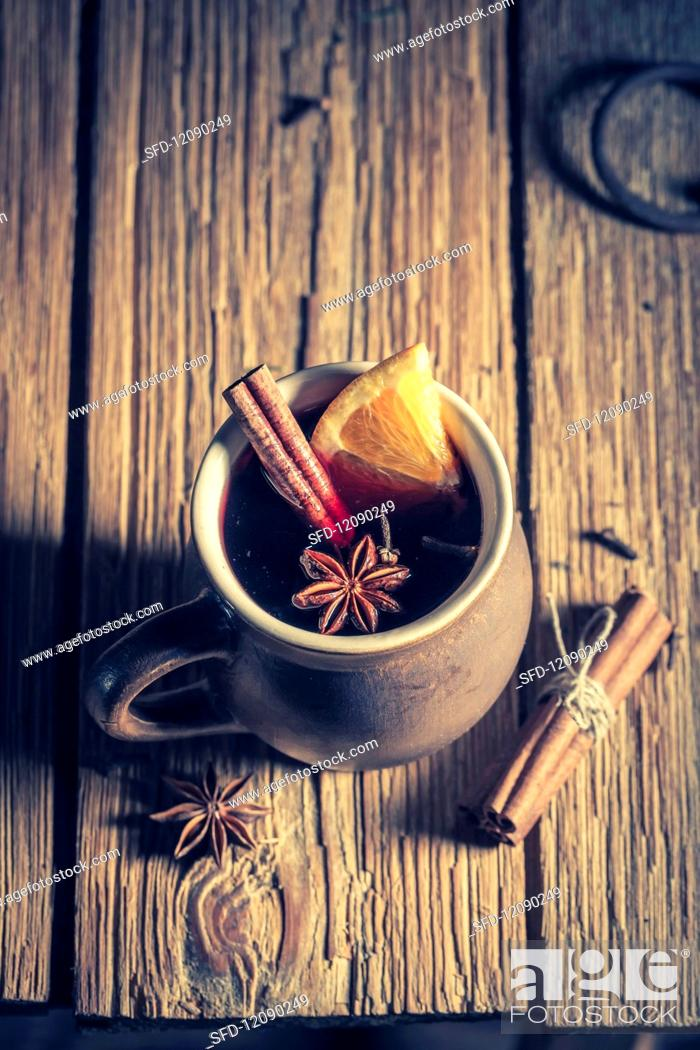 Aromatic Mulled Wine With Spices On A Rustic Wooden Table