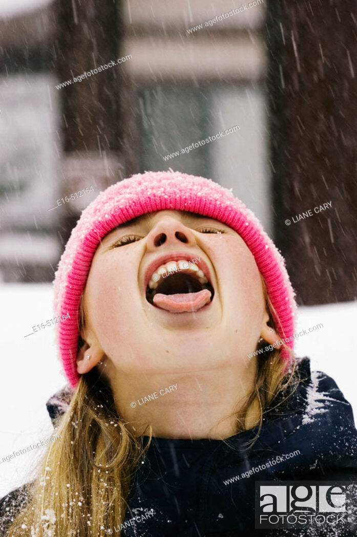 Stock Photo: Girl catching snow in mouth.