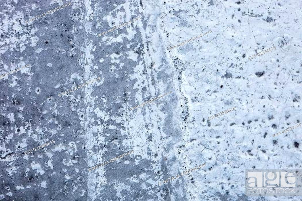 Photo de stock: Partly whitewashed concrete wall with rich and various texture.