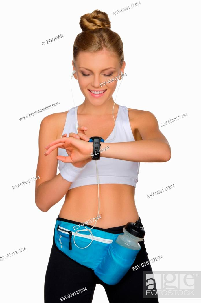 Photo de stock: Sports woman controls her health while exercising.