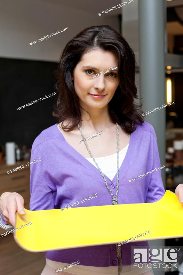 Stock Photo: Woman carrying a tray.