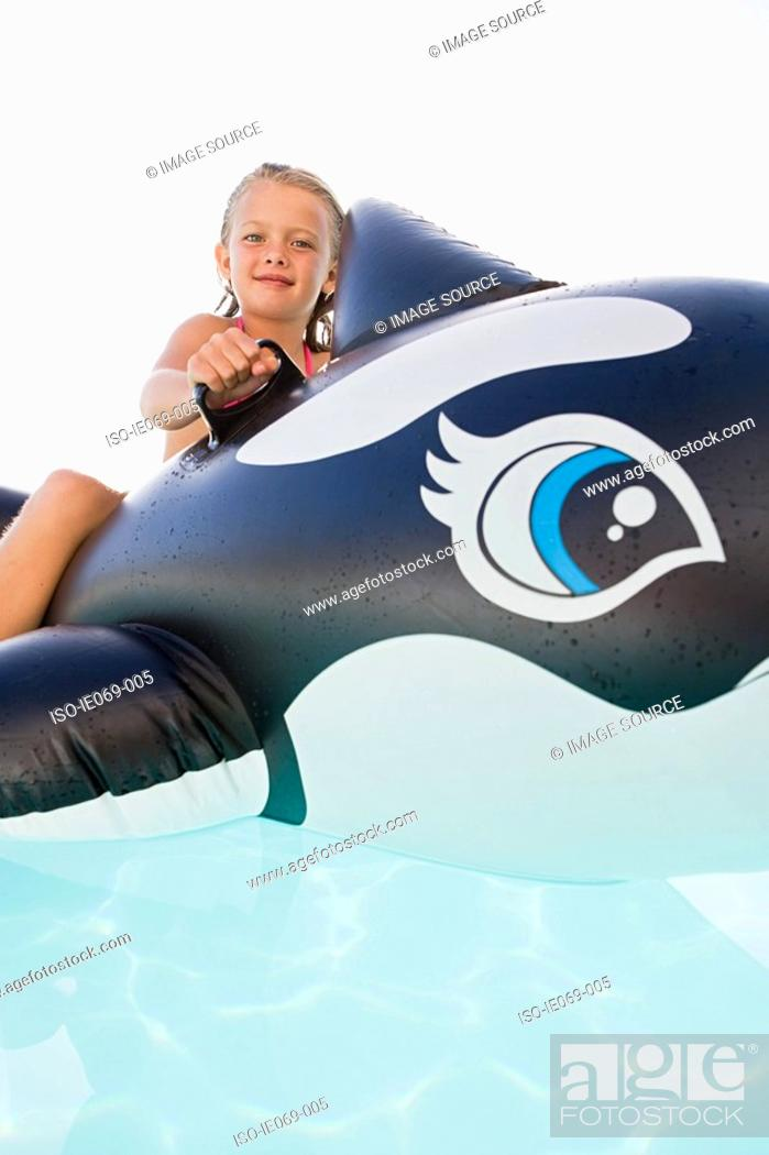 Stock Photo: Girl on inflatable whale.